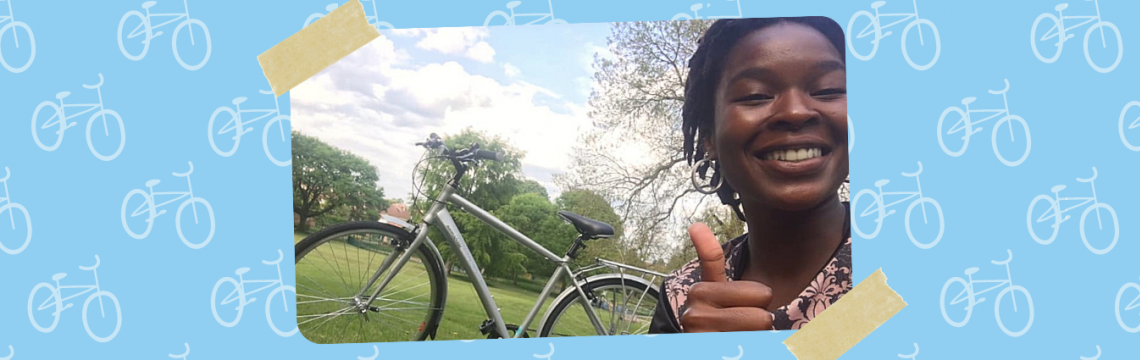 Thembi giving the thumbs up with her new bike.