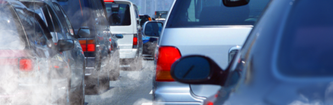 Close up of a traffic jam with exhaust fumes swirling between the cars